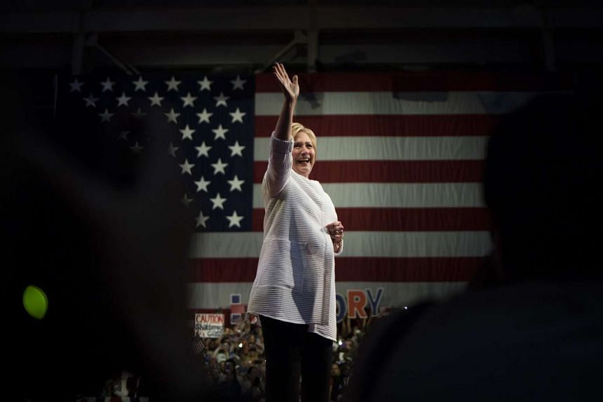 Hillary Clinton waves to attendees during a primary night event at the Brooklyn Navy Yard in the Brooklyn borough of New York on June 7, 2016.
