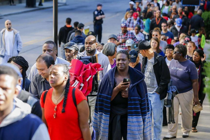 People wait in a long line for free tickets to the memorial service for late boxer Muhammad Ali.
