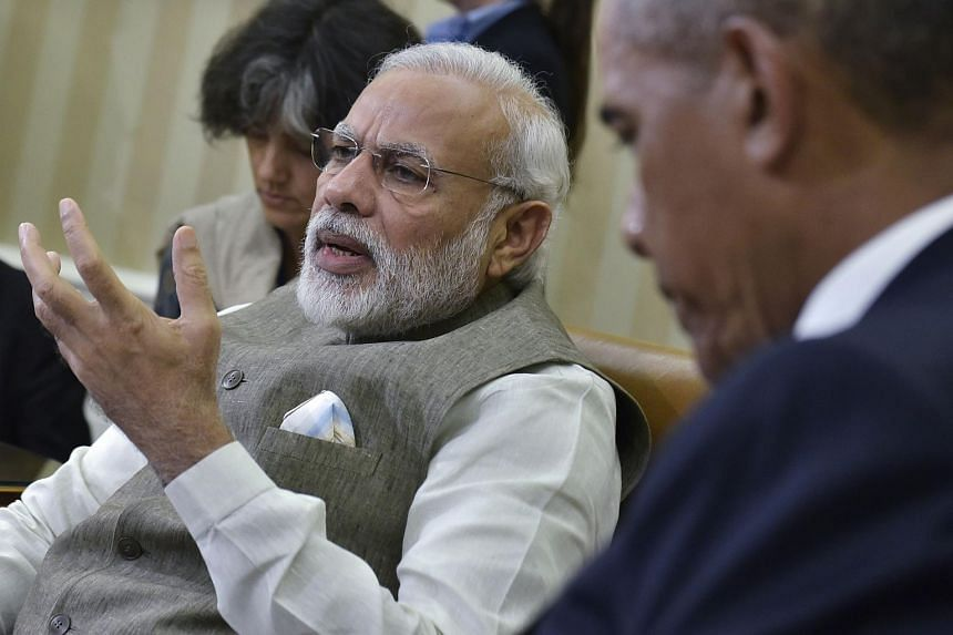 Indian Prime Minister Narendra Modi (left) speaking during a meeting with US President Barack Obama at the White House on June 7.