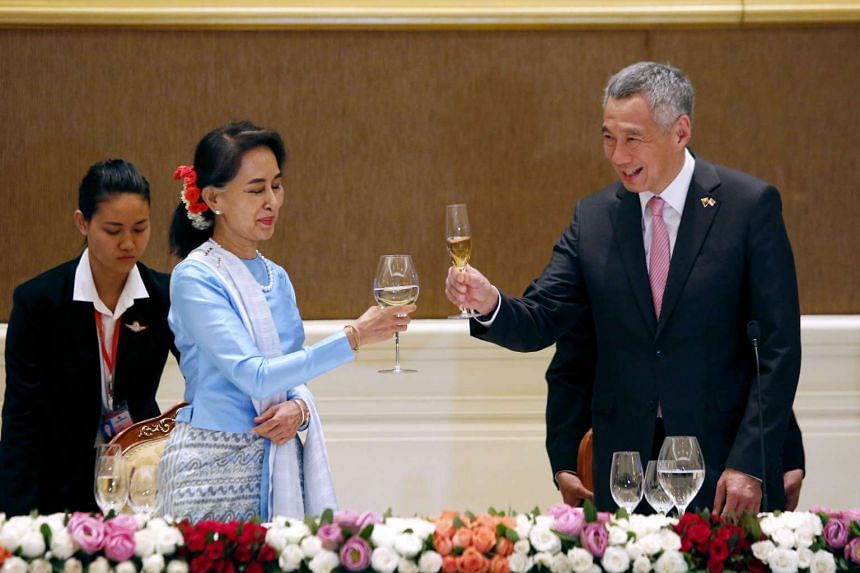 Myanmar State Counsellor Aung San Suu Kyi (left) and Singapore Prime Minister Lee Hsien Loong toasting at a dinner in Naypyidaw on June 7.