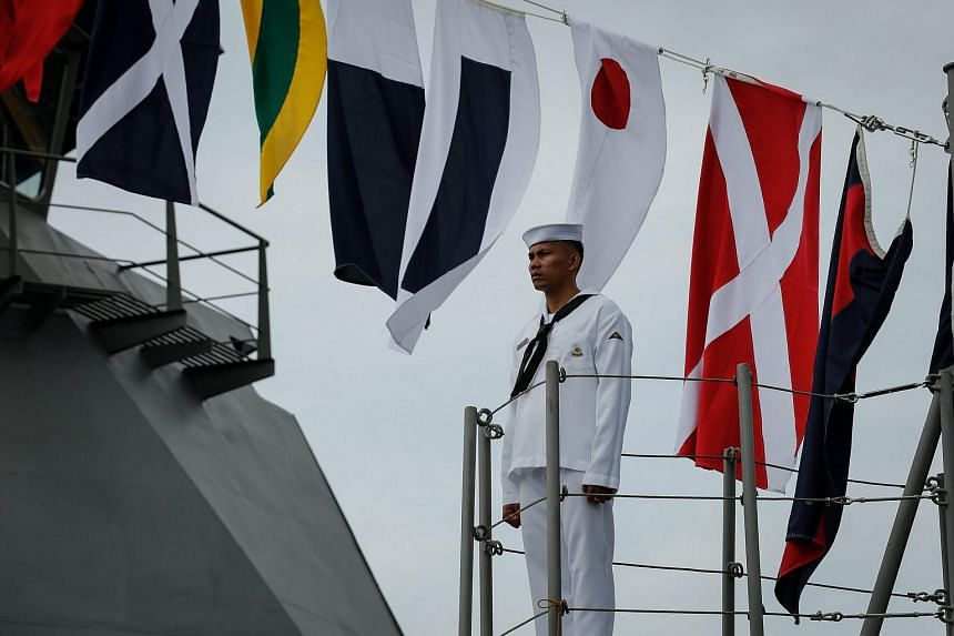 A Filipino navy personnel standing onboard a ship during the Philippine Navy's 118th anniversary at a port in Manila on June 1.