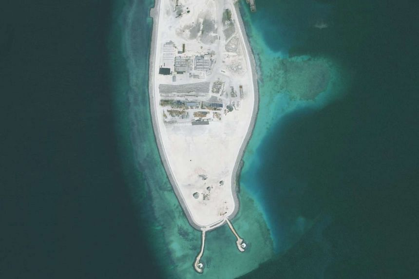 One of the two new lighthouses is being built on Mischief Reef (left), while the other is on Fiery Cross Reef. Lighthouses are part of Beijing's controversial expansion and building of civilian and military facilities in the South China Sea.
