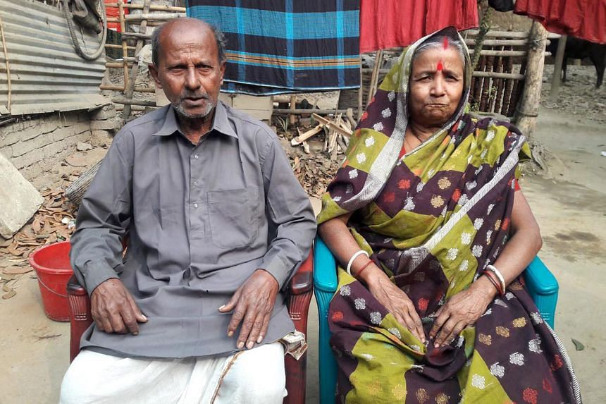 Mr Ganguly with his wife in an undated photo. ISIS said it was behind his killing but Bangladesh police doubt the group's claim.
