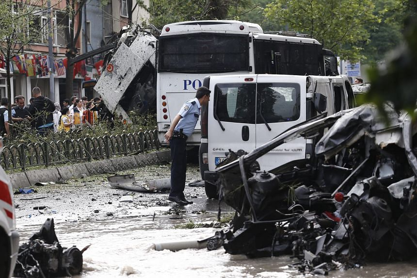 A police officer at the scene of the bomb attack on a police bus in Istanbul yesterday. The blast occurred close to some of the city's major tourist sites.