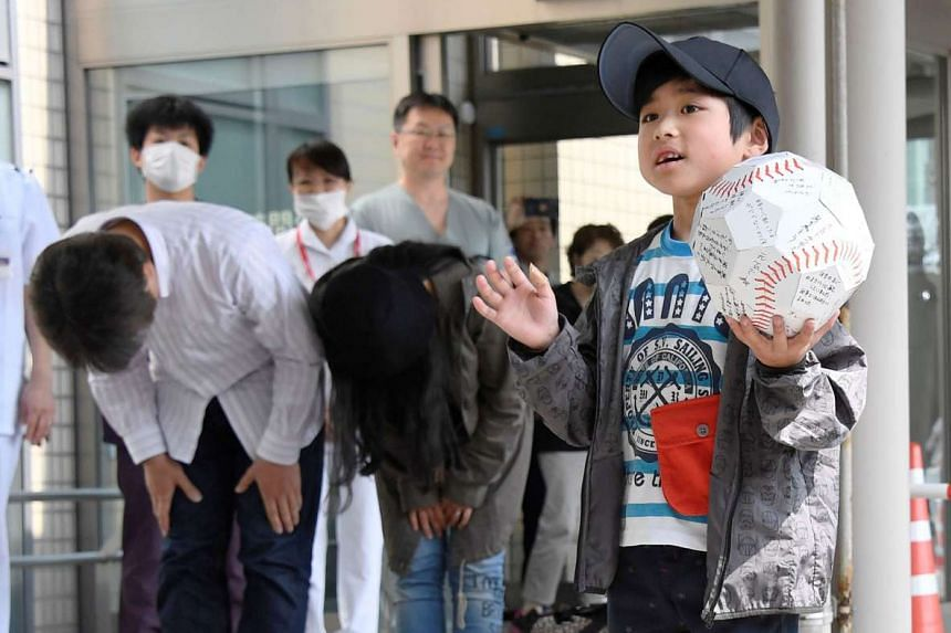 Yamato greets the crowd as he leaves Hakodate Municipal Hospital while his parents bow. Many in Japan were angry at the couple, who abandoned their son in a forest to teach him a lesson. Police said that the parents will not face charges.