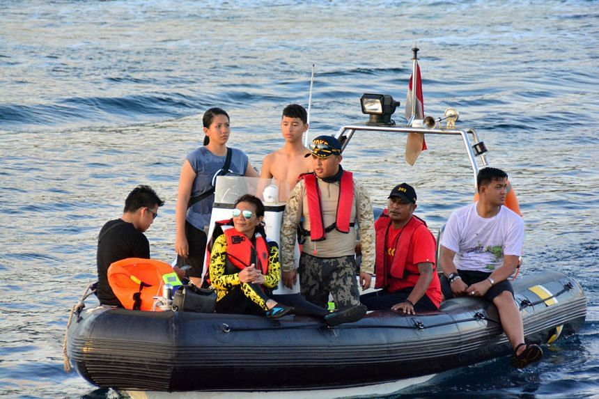 Maritime Affairs and Fisheries Minister Susi Pudjiastuti (centre) monitoring Komodo National Park waters during a visit to West Manggarai, Flores, East Nusa Tenggara, on Monday.