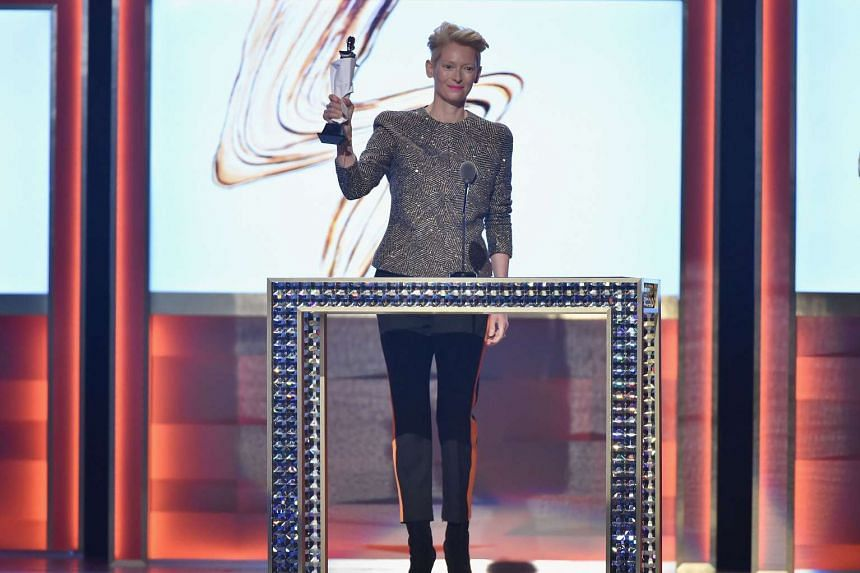 Actress Tilda Swinton (above) accepted the Board of Director's Tribute Award on behalf of Bowie's widow, Iman.