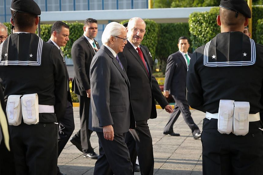 President Tony Tan Keng Yam is received by Mexico's Assistant Secretary of Foreign Affairs Carlos Alberto de Icaza Gonzalez at the Benito Juarez International Airport.