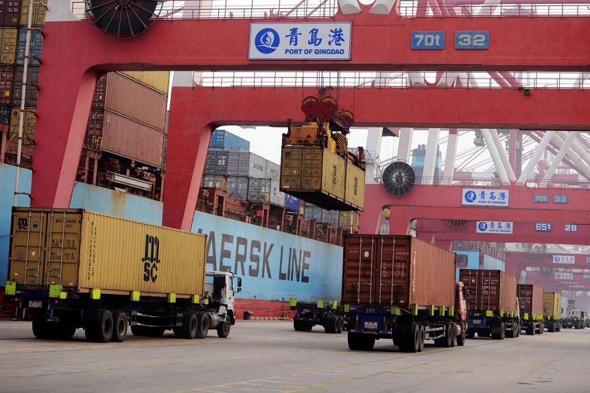 Container trucks at a port in Qingdao.