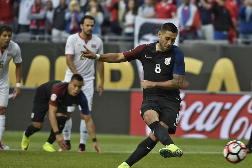 USA's Clint Dempsey scoring a penalty against Costa Rica.