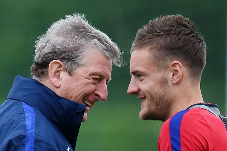 England manager Roy Hodgson (left) with striker Jamie Vardy during an England training session.