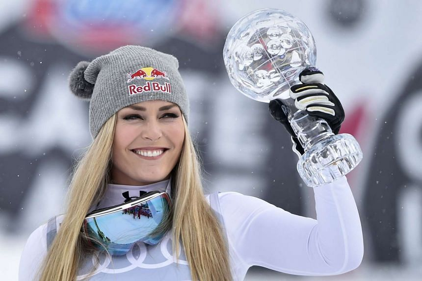 Vonn poses with the Women's downhill discipline crystal globe trophy at the FIS Alpine Skiing World Cup finals.