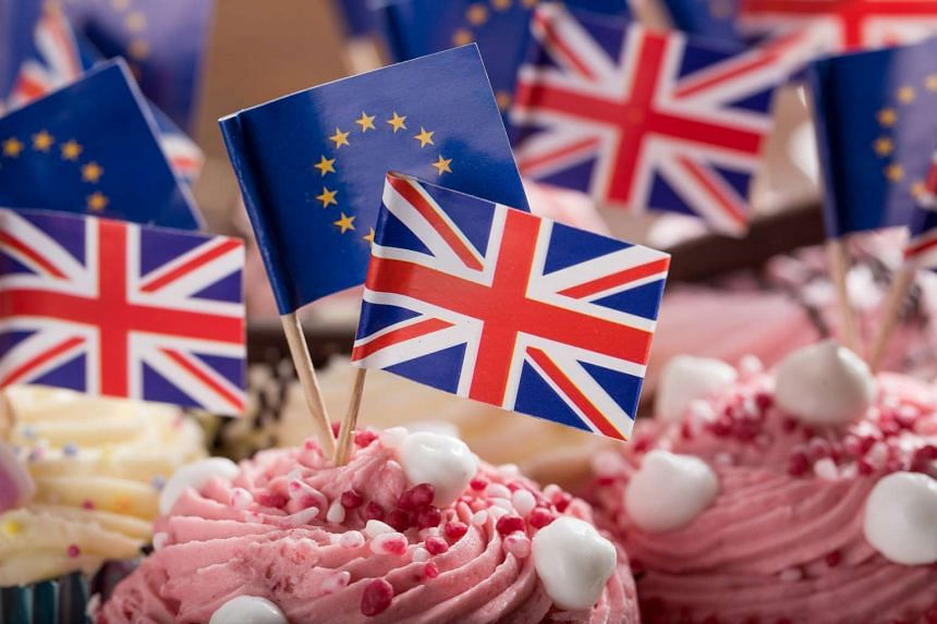 British and EU flags on cupcakes. Voter registration will be extended by 48 hours.