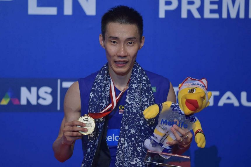 Lee Chong Wei shows his medal after winning the men's singles final at the Indonesian Open in Jakarta, on June 5, 2016.