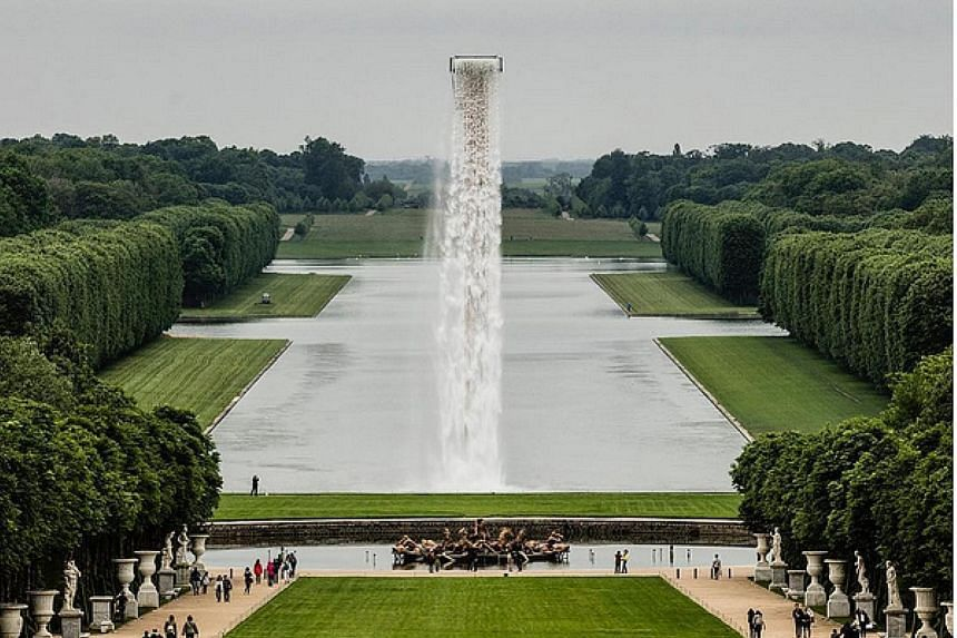 The installation cascades into the Grand Canal of the Gardens of Versailles.
