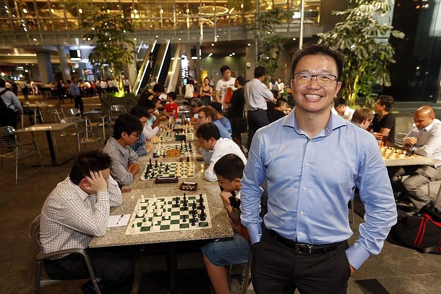 Mr Loh at The Cube in Asia Square Tower 1, where players of his after-work chess community battle it out every Wednesday.
