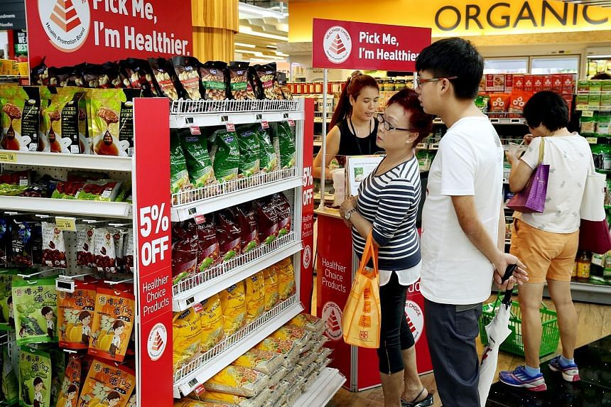 Supermarkets, including FairPrice Xtra at JEM shopping mall (above), are promoting wholegrain rice items as the Health Promotion Board says white rice is its main concern in fighting diabetes.