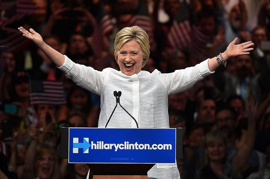 Mrs Clinton secures her place in history as the first woman presidential candidate of a major political party in the US.