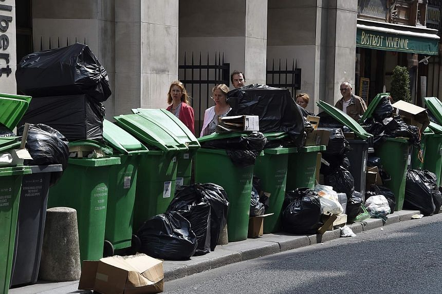 With just two days to go before the Euro 2016 football championship kicks off in France, rubbish piled up yesterday on the streets in parts of Paris (left) and other French cities, as waste treatment workers continued to strike and picket garbage col