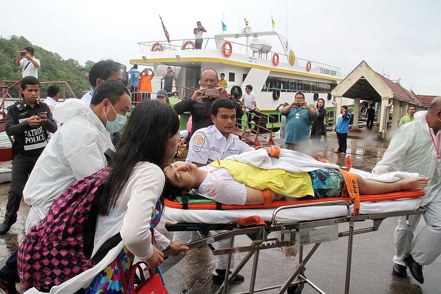 Rescue workers ferrying an injured foreign tourist to an ambulance after the collision near Phi Phi island yesterday. Two Chinese tourists were killed and three Chinese nationals are in critical condition.