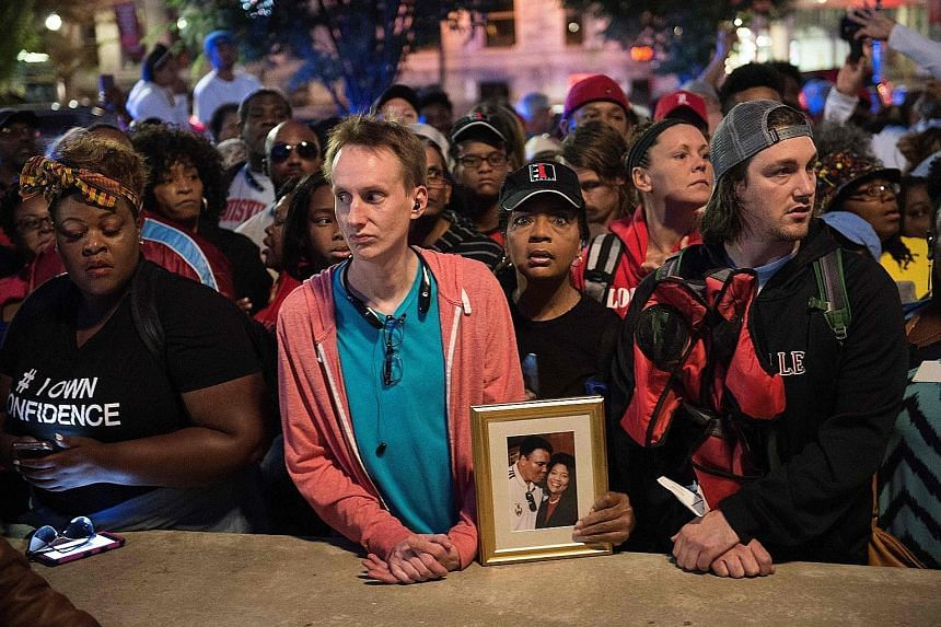 People queueing yesterday for tickets to attend boxing legend Muhammad Ali's funeral service in Louisville, Kentucky, tomorrow. He died last week after a decades-long battle with Parkinson's disease.
