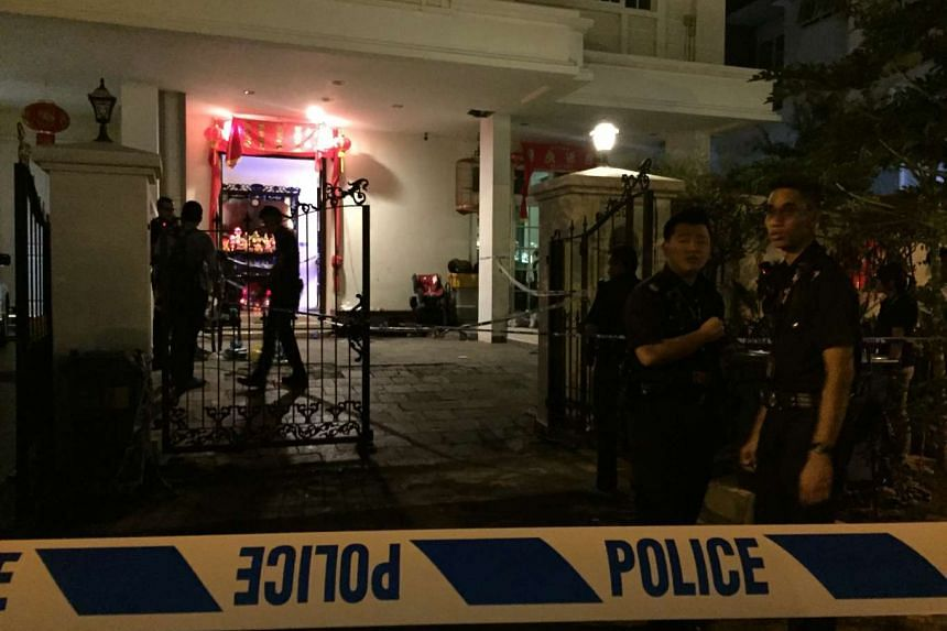 Police officers investigating the scene of an alleged stabbing at Telok Kurau on June 7, 2016.