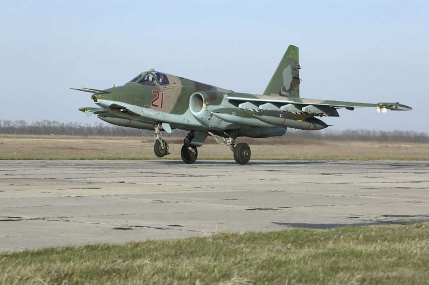 A Russian Sukhoi Su-25 fighter jet arriving from Syria lands at an airbase southern Russia, in this March 16, 2016, handout photo by the Russian Ministry of Defence.