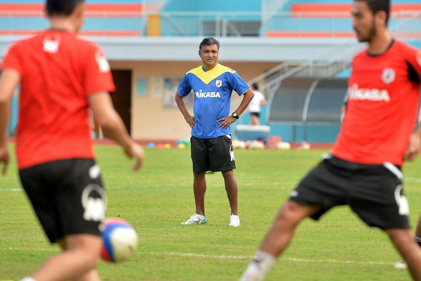 Coach V. Sundramoorthy (centre) overseeing a Tampines Rovers training session, on July 30, 2015.