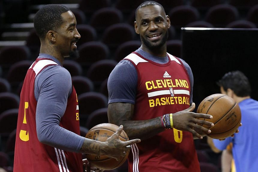 Cleveland Cavaliers forward LeBron James (right) and Cleveland Cavaliers guard J.R. Smith (left), during NBA Finals practice at Quicken Loans Arena in Cleveland, Ohio, US, June 7.