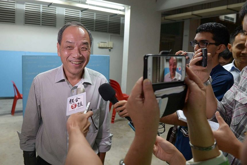 WP chief Low Thia Khiang taking questions from the media at the sidelines of his Meet-the-People Session on June 2.