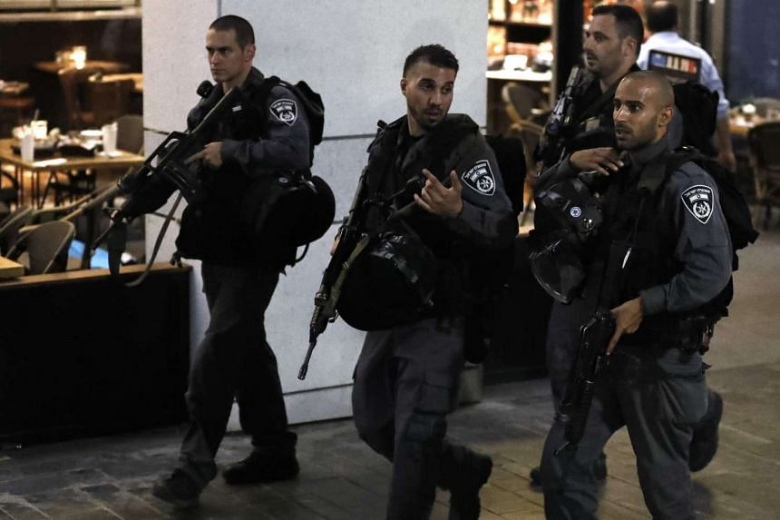 Israeli security forces at the scene of the shooting.