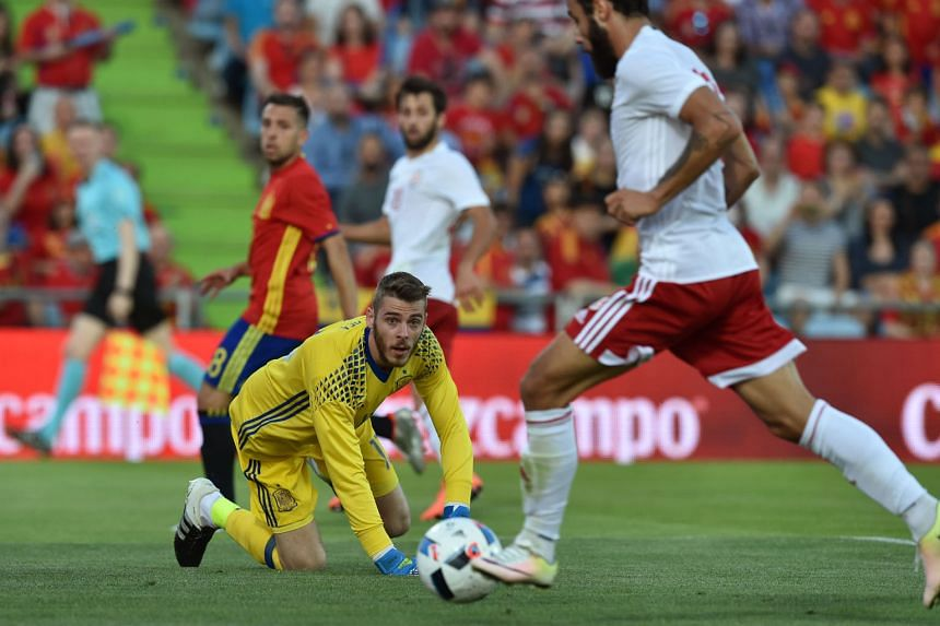 Georgia's Tornike Okriashvili finishing past Spain goalkeeper David de Gea to consign the Spanish to defeat in their last friendly before they begin their title defence.