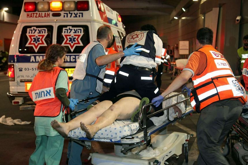 Israeli medics arrive with an injured person at a hospital a few moments after the shooting attack.