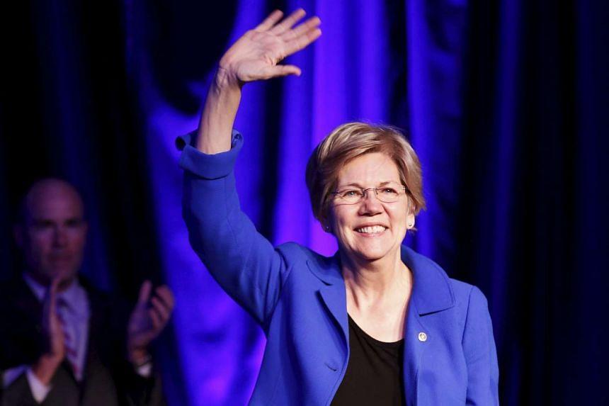Senator Elizabeth Warren waves at the BlueGreen Alliance Foundation's 2015 Good Jobs, Green Jobs Conference in Washington, April 13, 2015.