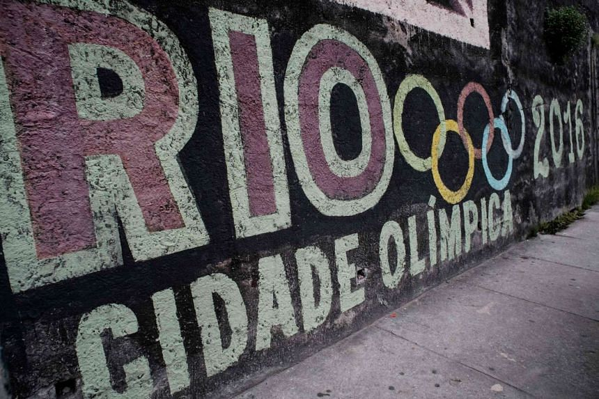 A graffiti with the logo of the Olympic Games on a wall of Rio de Janeiro, Brazil, on June 4, 2016.