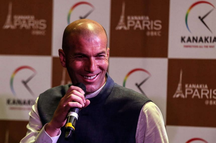 Real Madrid's head coach Zinedine Zidane smiles during a media conference in Mumbai, India on June 10, 2016.