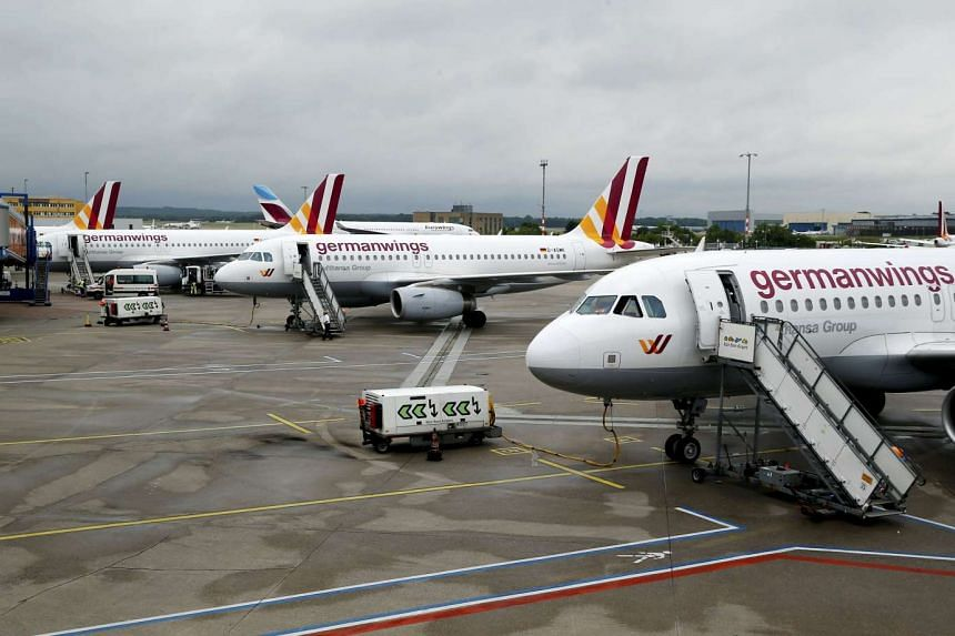 Delayed Germanwings planes wait on the tarmac following a security alert at Cologne airport, in Cologne, Germany, on May 30, 2016.