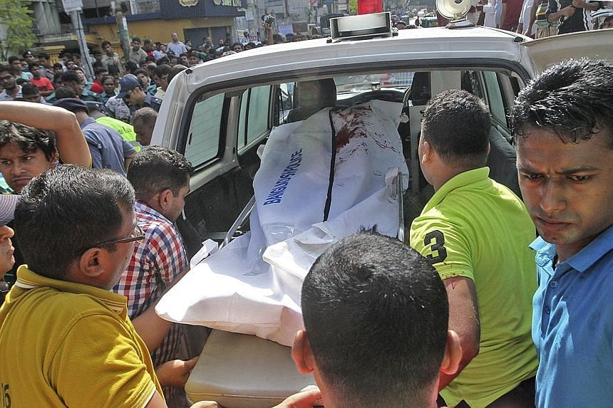 The body of Ms Mahmuda Khanam Mitu, wife of police superintendent Babul Akter, being taken away in Chittagong on Sunday after she had been attacked by three assailants while taking her son to school.