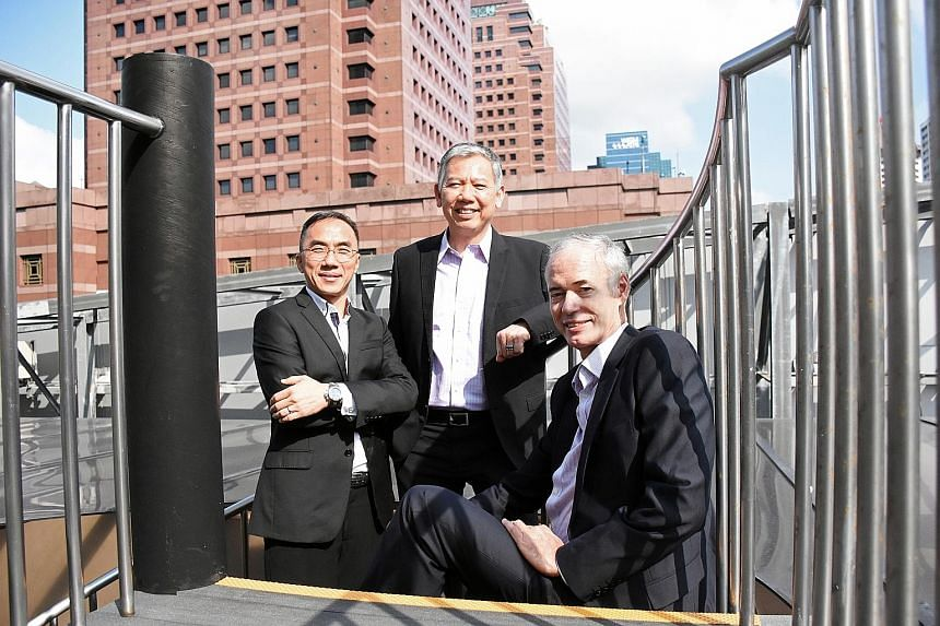 A team including UNSW's Associate Professor Chong Chee Mun (middle) and Professor Stuart Wenham (at right) came up with a method to reverse the light-induced degradation of solar cells (above). The UNSW professors are teaming up with NTU's Adjunct As