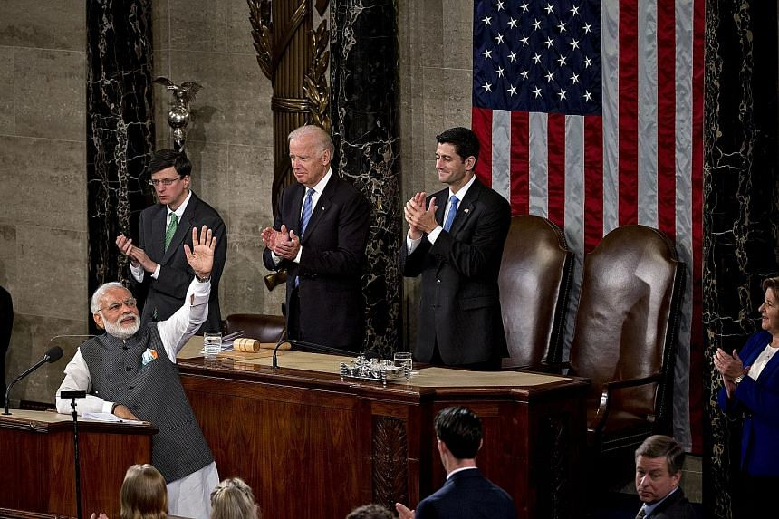 Mr Modi acknowledging the applause after making an hour-long speech to a joint session of the US Congress on Wednesday at the US Capitol in Washington. Behind the Indian Prime Minister are US Vice-President Joe Biden (centre) and Speaker of the House