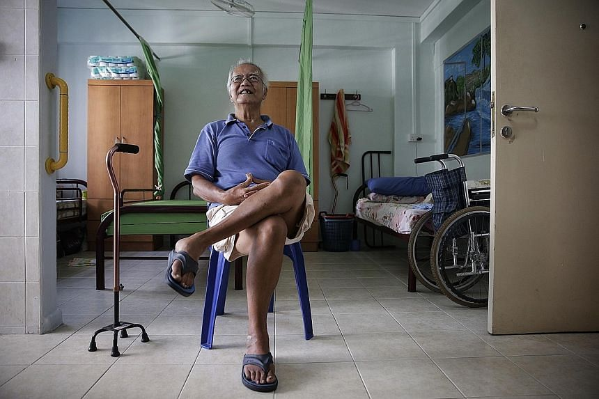 Mr Kang, a retired odd-job labourer, in the one-room flat which he shares with a flatmate at the Pecco senior group home. He moved to the home about a year ago after living in two dormitory- style homes for the elderly for about 10 years.