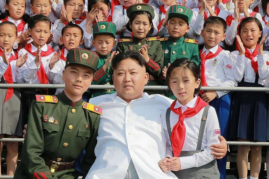 North Korean leader Kim Jong Un at a photo session with representatives of the 70th founding anniversary of the Korean Children's Union in Pyongyang. The isolated state's official Korean Central News Agency released the undated picture on Wednesday.