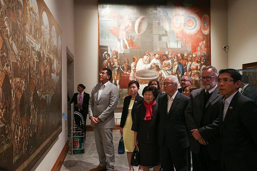 President Tony Tan Keng Yam (third from right) and his wife Mary Tan visiting Chapultepec Castle, now the National History Museum, in Mexico yesterday. They were hosted by museum director Salvador Rueda Smithers (second from right). With them are (fr
