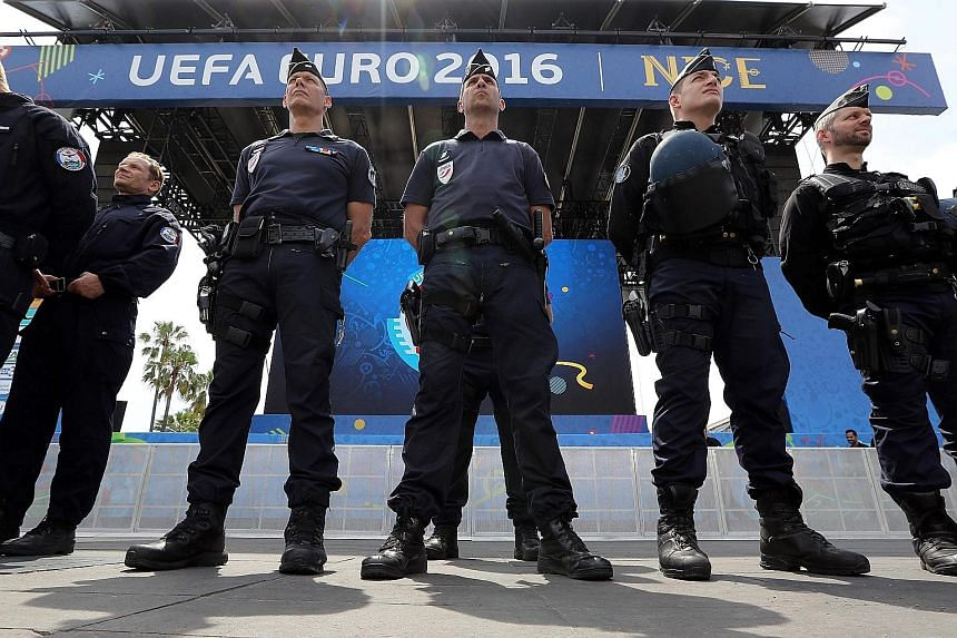 French police standing guard at a fan zone in Nice, France, on Wednesday. The country is on heightened alert for terrorist attacks during the Euro 2016 football championships taking place from today (local time) to July 10.