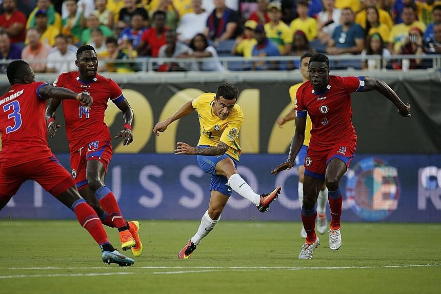Brazil midfielder Philippe Coutinho (centre) opening the floodgates with his first goal during the 7-1 thrashing of Haiti in Group B of the Copa America Centenario.