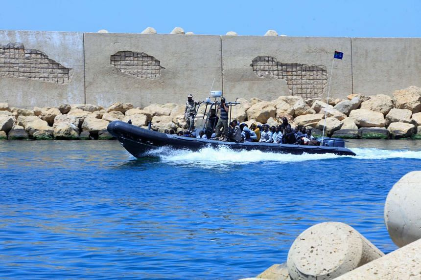 A Libyan Navy boat transporting migrants who attempted to flee to Europe back to Tripoli on June 7.