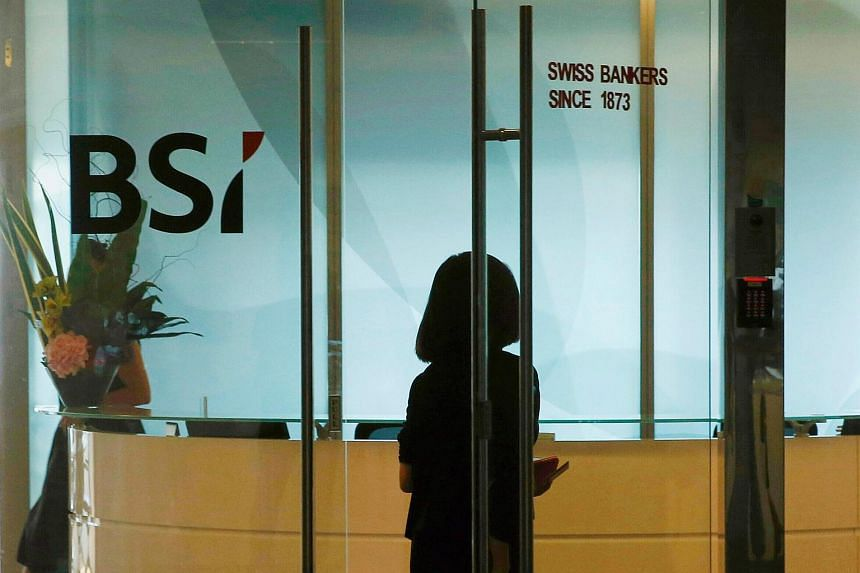 An employee entering the office of Swiss bank BSI in Singapore.