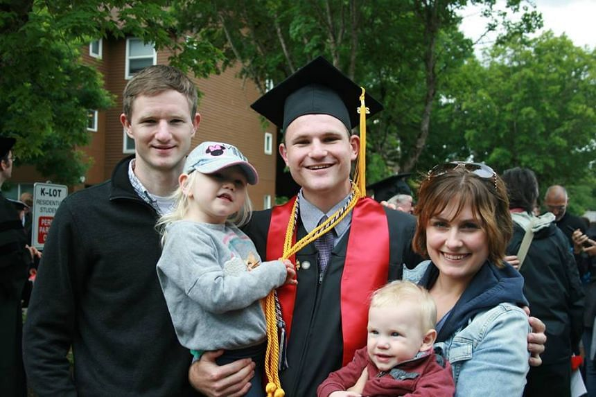 Colin Nathaniel Scott (centre) at his recent graduation from Pacific University, in Forest Grove, Oregon.