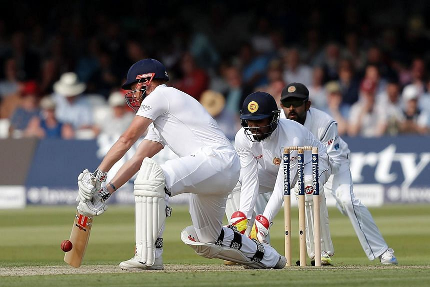 England batsman Jonny Bairstow (left) plays a shot during play on the first day of the third Test match between England and Sri Lanka in London on June 9.