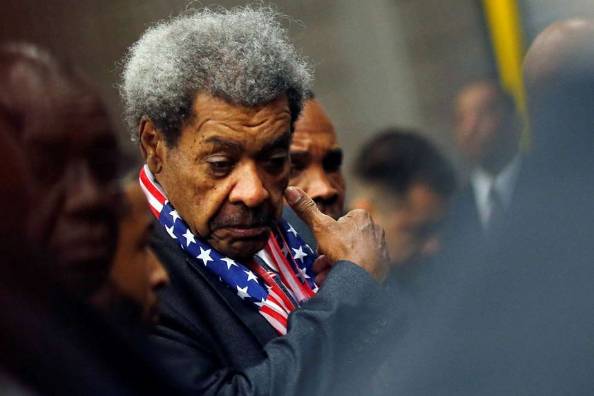 Boxer promoter Don King reacts as he attends the jenazah.